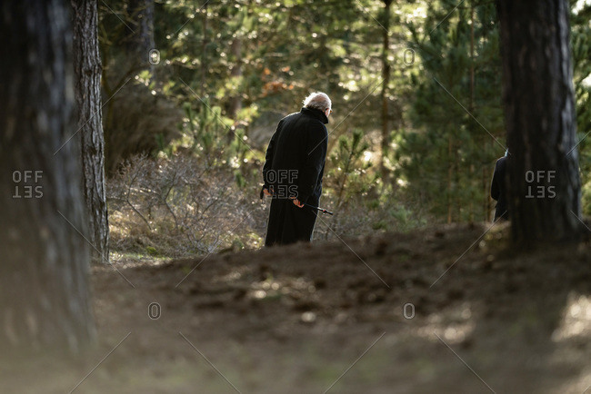 Senior man walking in a forest