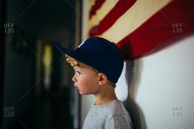 Profile portrait of a boy wearing a baseball cap