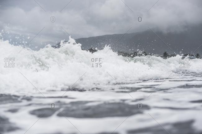 Splashing waves in the Pacific ocean off the coast of Mo'orea Island, French Polynesia
