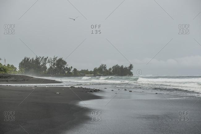 Waves rolling into the shore of Mo'orea Island, French Polynesia