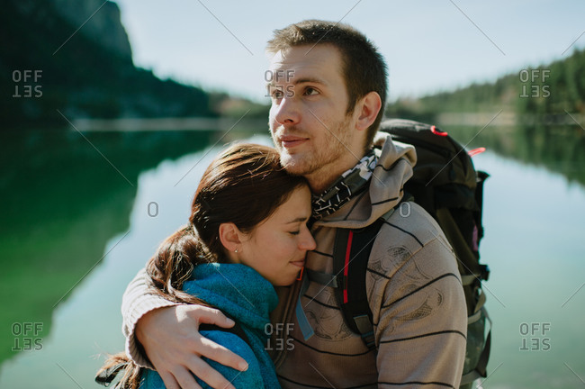 Young couple embracing at mountain lake