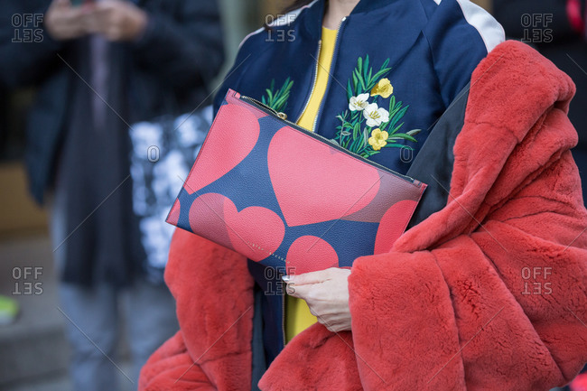 Close up of woman wearing a red plushy coat