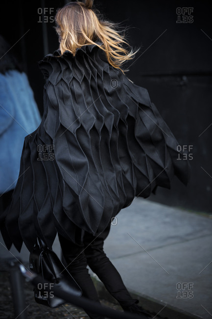 Woman wearing a black cape