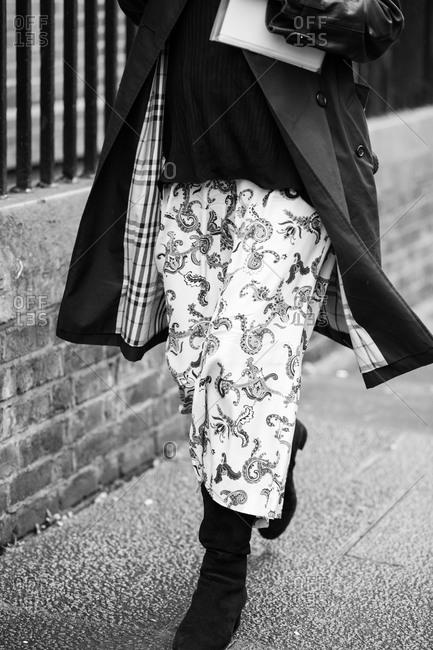 Woman walking in a printed skirt
