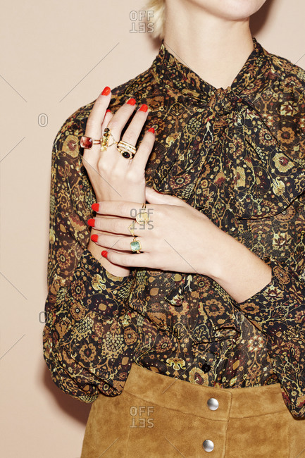 Young female in a floral blouse with red nail polish