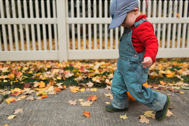 Boy walking down the sidewalk dressed in costume for Halloween