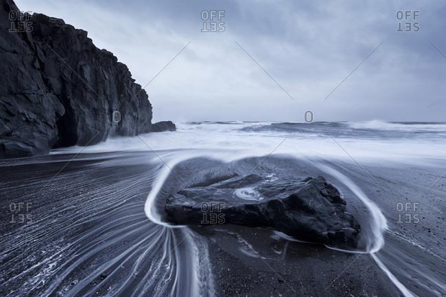 Beach with solidified lava near Laekjavik, Iceland