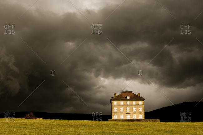 Ghostly villa and cloudy skies