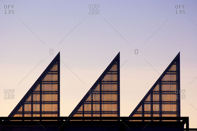 Office building steel glass construction in the evening