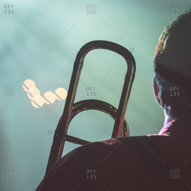 Close-up of a person holding a trombone