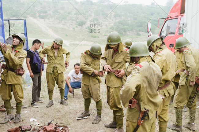 Beijing, China - July 20, 2012: Actors and crew in a war film at a shooting site in a suburb of Beijing, China