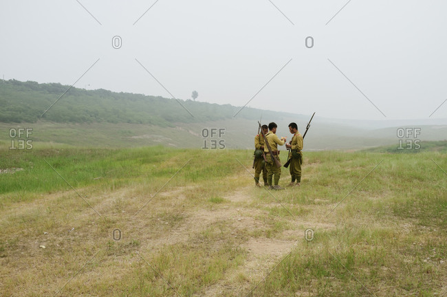 Beijing, China - July 20, 2012: Actors in a war film taking a break in a suburb of Beijing, China