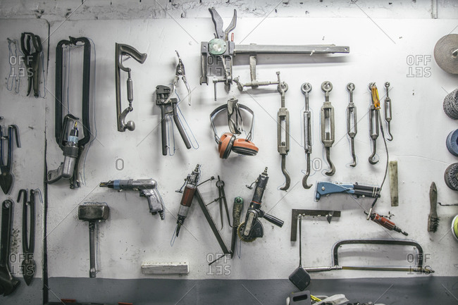 Tools hanging on the wall of a workshop
