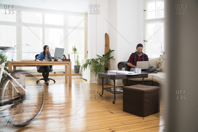 Two creative business people working in informal office