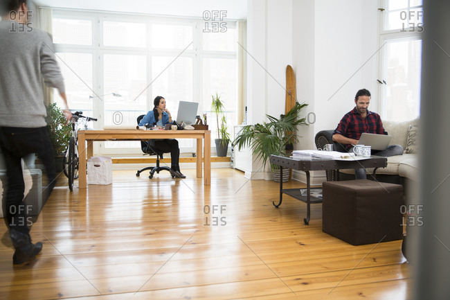 Three creative business people working in informal office