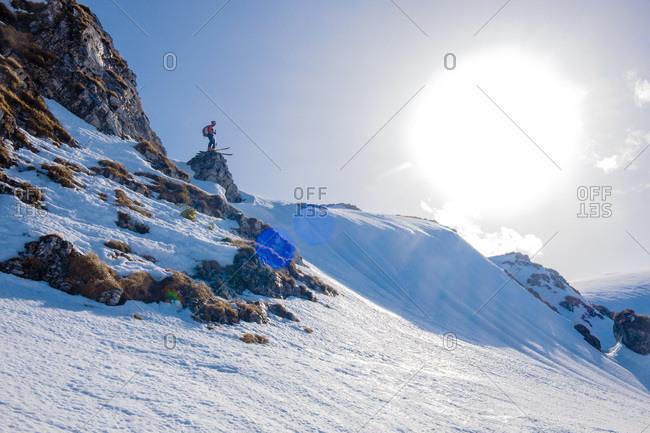 Romania, Southern Carpathians, skier in winter landscape