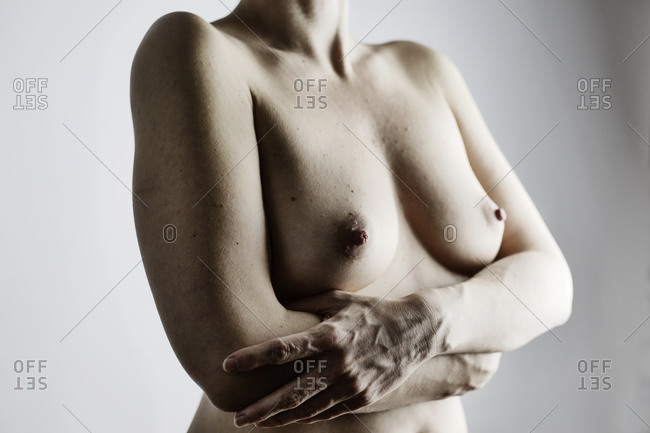 Breasts of nude woman