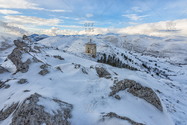 Italy, Abruzzo, Gran Sasso e Monti della Laga National Park,  The small church of Santa Maria della Pieta in Rocca Calascio at sunset in winter