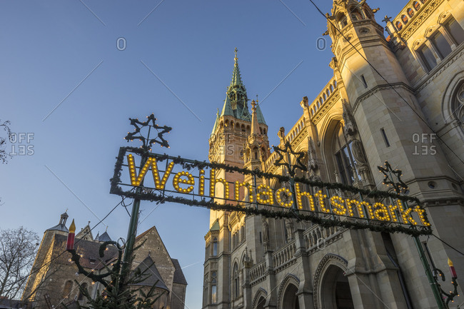 Germany, Braunschweig, Christmas market sign at townhall in the evening