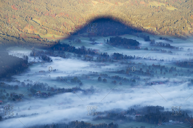 Germany, Upper Bavaria, morning fog in Isar valley, shadow of mountain, view from Geierstein