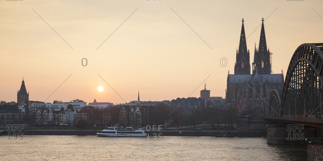 Germany, Cologne, view to the old town and Cologne Cathedral by sunset