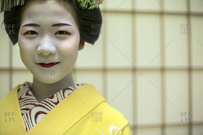 Japan - June 17, 2014: Portrait of a Geisha in a tea house