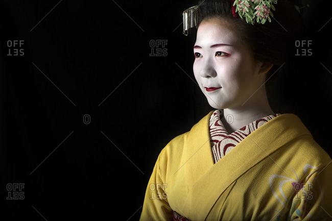 Japan - June 17, 2014: Portrait of a Geisha on a dark background