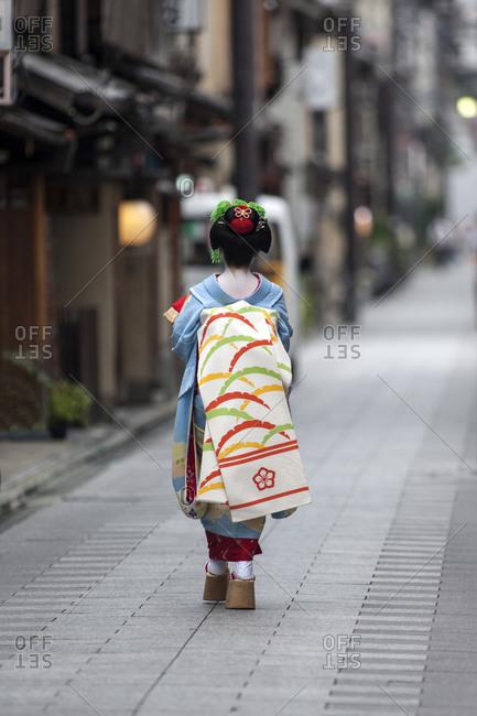Japan - June 17, 2014: Geisha walking along the street