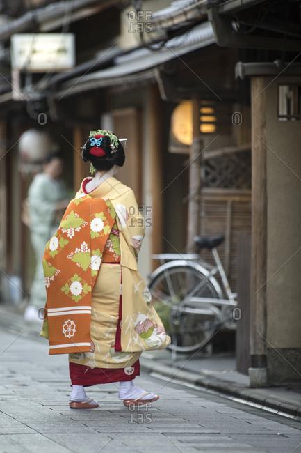 Japan - June 19, 2014: Geisha walking along the street
