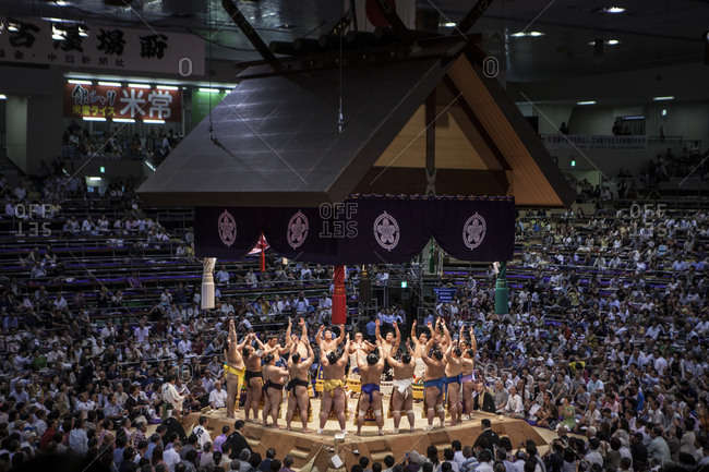 Japan - July 15, 2014: Sumo wrestlers in a ring entry ceremony