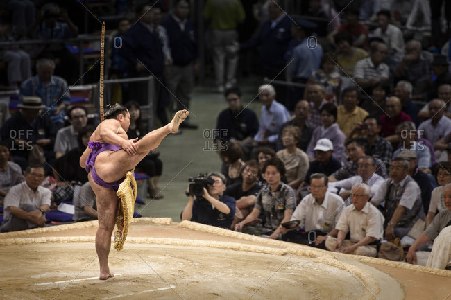 Japan - July 15, 2014: Sumo wrestler stretching leg