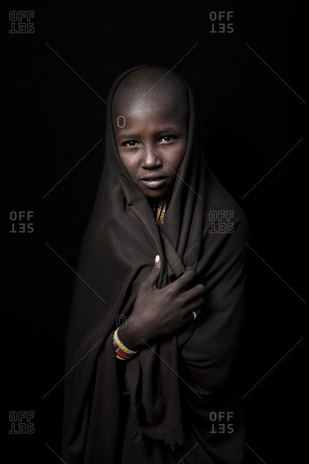 Africa - July 25, 2011: Portrait of an Arbore girl on a dark background