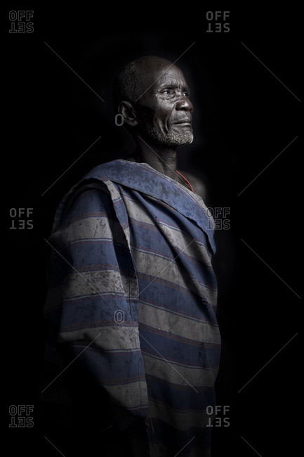 Africa - July 31, 2011: Portrait of a Mursi tribesman on a dark background