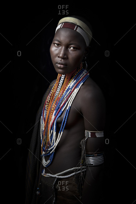 Africa - July 25, 2011: Portrait of an Arbore woman on a dark background