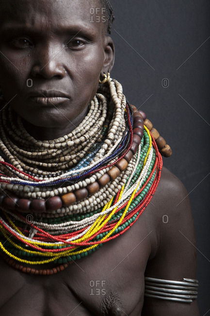 Africa - July 27, 2011: Portrait of a Mursi woman on a dark background
