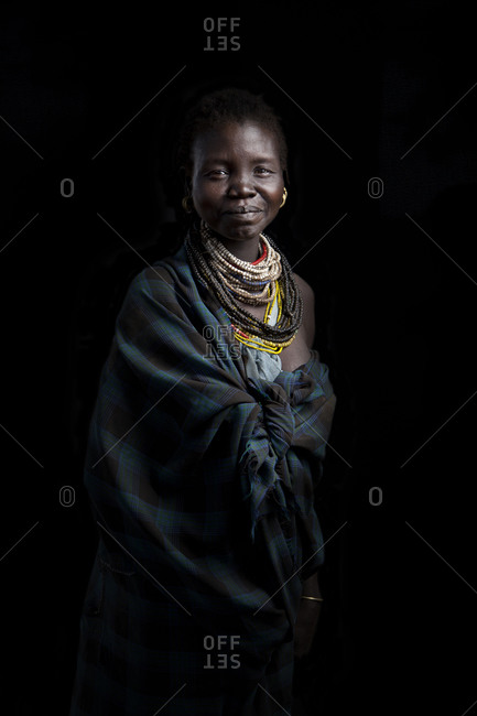 Africa - March 19, 2016: Portrait of a Mursi woman on a dark background