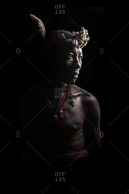 Africa - July 29, 2011: Portrait of an Hamar tribesman on a dark background