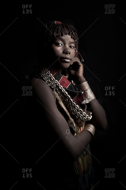 Africa - July 29, 2011: Portrait of an Hamar woman on a dark background