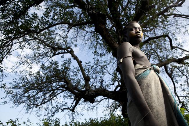Africa - July 31, 2011: Portrait of a Mursi tribesman displaying scarification