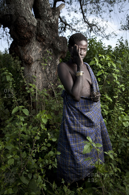 Africa - July 31, 2011: Portrait of a Mursi woman displaying scarification