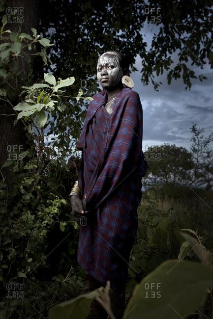 Africa - August 1, 2011: Portrait of a Mursi girl outside