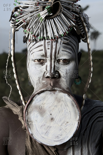 Africa - August 1, 2011: Portrait of a Mursi girl with a lip plate