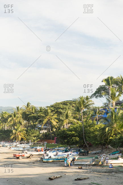 Beach with fishing activity in Mexico