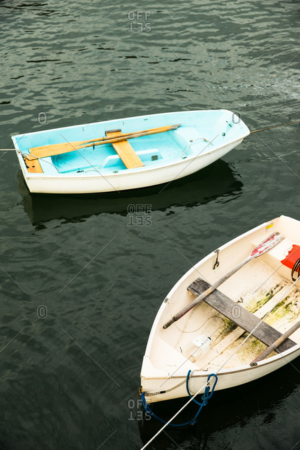 Rowboats floating in water