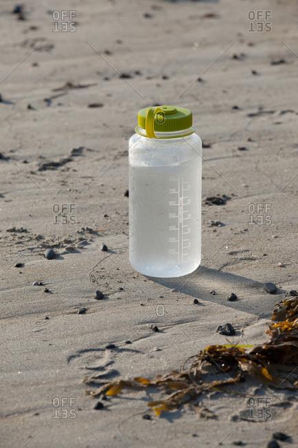 9/8/15: A water bottle on beach