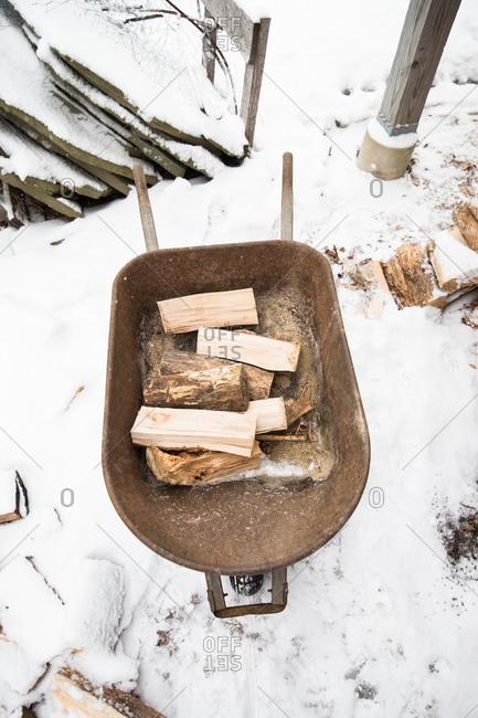 Chopped firewood in a wheelbarrow