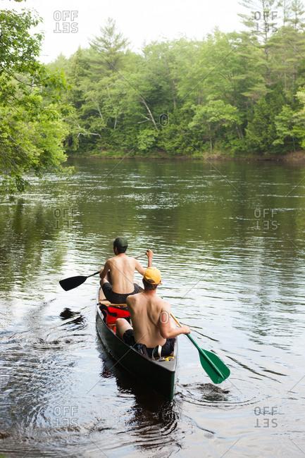 7/6/15: men paddle on river in canoe