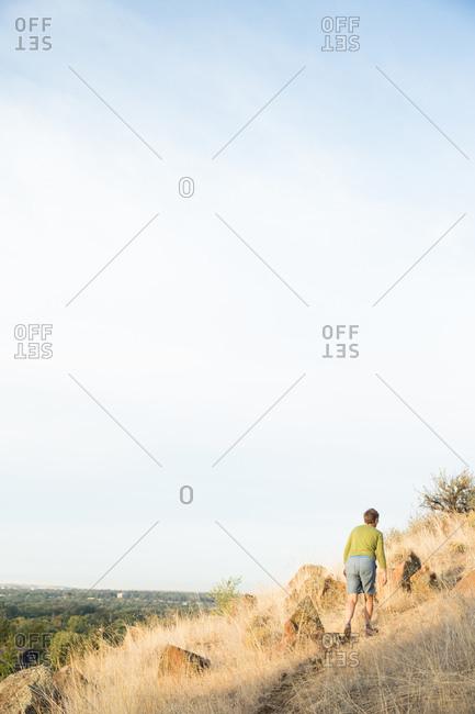 Woman walks through foothills in Idaho