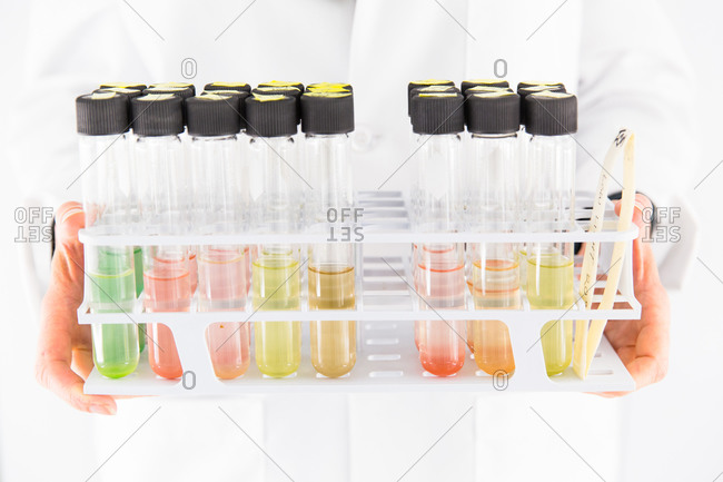 Holding vials filled with liquid