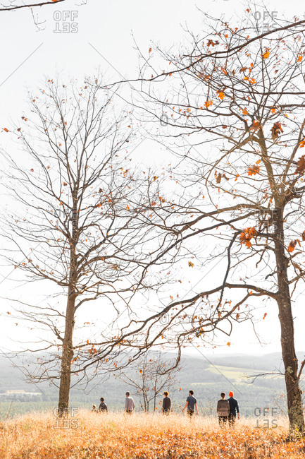 People walking in rural autumn setting